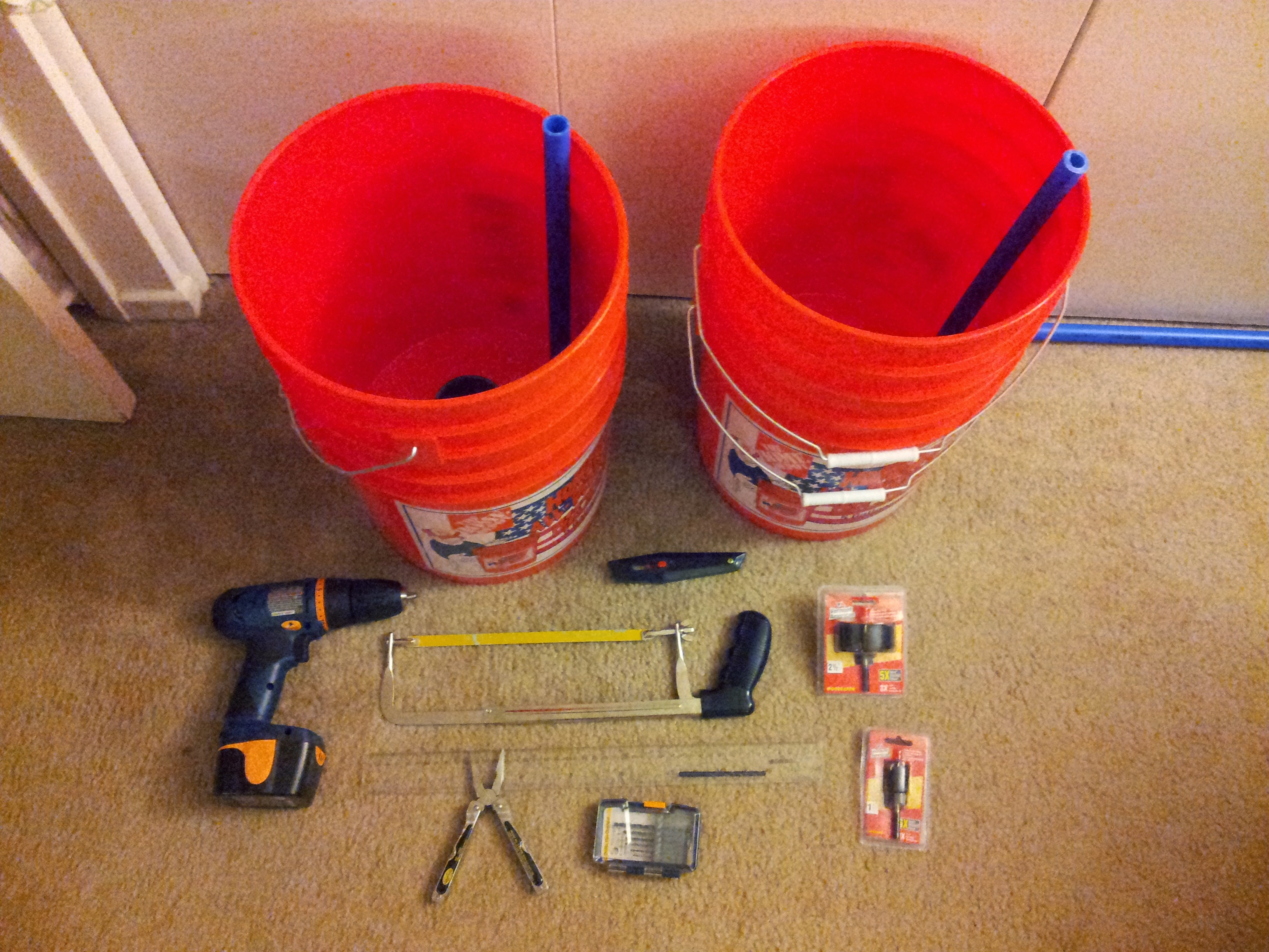 Materials needed for a self-watering bucket container.